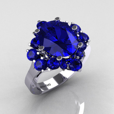 Classic 10K White Gold 4.0 Carat Oval and 1.0 Carat Round  Blue Sapphire Cluster Engagement Ring R87-10KWGBS-1